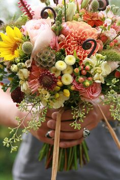A lovely earthy bouquet with fiddle head ferns and seed pods