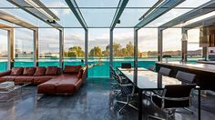 Lap pool constructed on the side of a house with a full length window looking out from the living space. Pinned to Pool Design by Darin Bradbury.