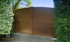 Aluminium wood effect driveway gates Beare Green, Dorking BFT ELI underground operators AES intercom