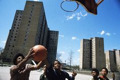 """""""Youths Play Basketball At Stateway Gardens' Highrise Housing Project On Chicago's South Side. Champs, Black History Month Activities, Chicago Sun Times, Chicago City, Chicago Illinois, Korea, Still Picture, Photo Maps, My Kind Of Town"""