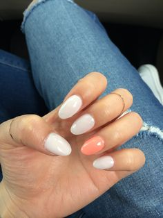 White and orange almond nails.