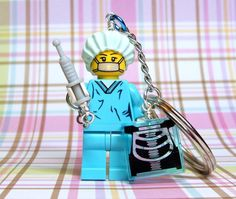 Introducing a darling new key chain made from a brand new Surgeon LEGO® Series 6 Collection Minifigure. She is absolutely adorable in her aqua scrubs!