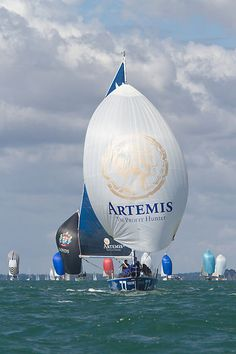 The Beneteau Figaro II yacht 'Artemis Figaro 3' with spinnaker at the start of a class 2 IRC race during Aberdeen Asset Management Cowes Week #sailboats #boats #sailing
