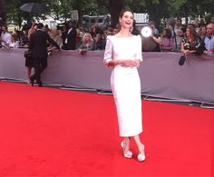 Lily James beaming on the #BAFTADownton red carpet. @DowntonAbbey
