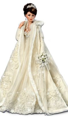 IT'S A DOLL BUT HIS WOULD BE BEAUTIFUL FOR A WINTER WEDDING... Not Barbie but she is BEAUTIFUL!!!
