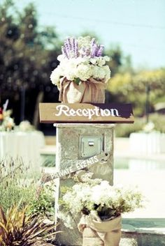 A rustic wedding sign (complete with lavender topper!) Photo by Anjuli