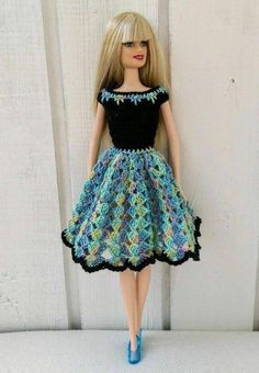 Handmade dress for Barbie doll or similar, by my own design. The crochet dress made of pink, blue. purple and black yarn and decorated with flowers. The dress are turned on the back with two transparent buttons. Doll and shoes is NOT included. Crochet Doll Dress, Crochet Barbie Clothes, Doll Clothes Barbie, Barbie Dress, Barbie Doll, Dress Clothes, Diy Crochet Bikini, Cute Crochet, Barbie Clothes Patterns