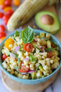 A smoky grilled corn salad loaded with fresh cherry tomatoes, avocado and basil leaves tossed in a refreshing vinaigrette