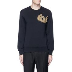 Alexander McQueen Sunflower embroidered organic cotton sweatshirt ($875) ❤ liked on Polyvore featuring men's fashion, men's clothing, men's hoodies, men's sweatshirts, black and alexander mcqueen