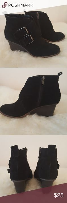 """Black suede wedge booties with buckle Dolce Vita black wedge booties originally purchased from Evereve. Excellent condition, tons of life left! Siver/pewter buckle detailing, inside zipper, pull tabs on back. Only selling these because my feet grew half a size after pregnancy. Rubber sole, 3"""" heel. Great for casual or dress up. Dolce Vita Shoes Ankle Boots & Booties"""