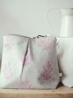 Peony and Sage - Finca Fabric Collection - A table with a white jug and two… Linen Bag, Natural Leather, Handmade Bags, Zipper Pouch, Handmade Silver, Cosmetic Bag, Purses And Bags, Tote Bag, Fabric
