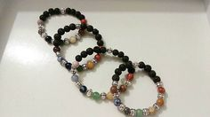 Check out this item in my Etsy shop https://www.etsy.com/listing/533459595/seven-chakras-bracelet-made-with-lava