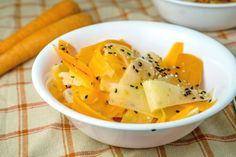 Healthy, delicious Daikon Carrot Salad recipe with a delicious sesame ginger dressing. Forget lettuce, and add a wonderful crunch to your dinner!