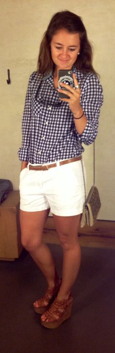 White shorts, gingham navy blue collared shirt, brown belt and wedges, pearl studs, Ray bans wayfarers, Southern Tide croakie. Perfect summer outfit.