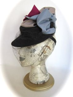 1940's felt doll hat with veil and stabilizer band. $125.00, via Etsy.