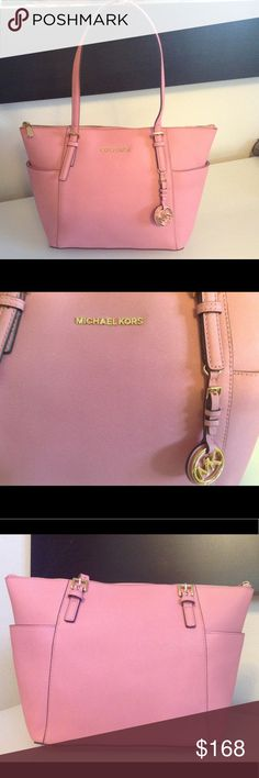 NWT Pink Michael Kors jet set Tote Bag The bag is brand new never used and still have the tag attached except it's missing one strap and a zipper pull in the inside. Please see pictures. Michael Kors Bags Totes
