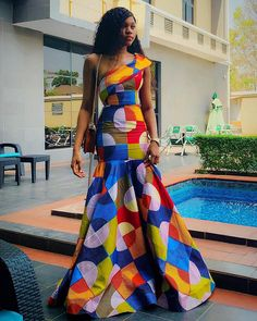 African wax African print Ankara mermaid fishtail dress at Diyanu Unique Ankara Styles, Ankara Long Gown Styles, Ankara Gowns, Ankara Dress, African Attire, African Wear, African Women, African Dress, African Style