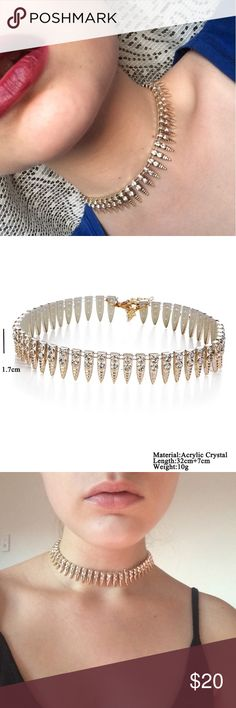 """Gold Jeweled Choker Necklace This gold painted plastic jeweled choker necklace is perfect for special occasions. With cute little """"teeth"""" around the choker this necklace is beautiful and unique. Wear with a tight body on dress for a daring look. ✔️15% off 2 or more items when you bundle  ✔️Click """"Add to a bundle"""" so I can offer you a private discount  ❌No trades Jewelry Necklaces"""
