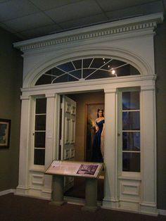 "Original doorway to Tara from ""Gone with the Wind,"" behind which is the painting of Scarlett from the movie."