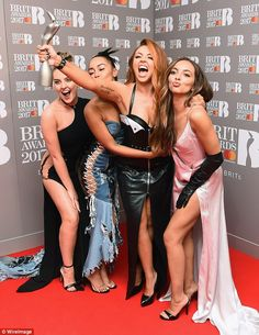 Jesy Nelson seemed to have a change of heart on Sunday, as she posted five photos of her Saturday night's Kids' Choice Awards' look in one go - appearing defiant against Perrie Edwards. Little Mix Brits, Little Mix Outfits, Little Mix Jesy, Little Mix Style, Jesy Nelson, Perrie Edwards, Meninas Do Little Mix, Little Mix Photoshoot, Brit Awards 2017