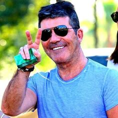 Simon Cowell and Syco Entertainment. The ultimate website for news, photos and in-depth interviews on Simon Cowell and his company. Paul Potts, Ella Henderson, Piers Morgan, Guinness Book, Britain Got Talent, Simon Cowell, World Records, American Idol