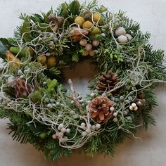 Spanish moss added to a fresh holiday wreath