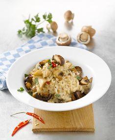 Risotto mit Chilischoten und Pilzen - mit Weißwein gekocht.