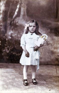 Vintage Photo:  Russian girl holding her doll.