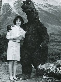 Behind-the-scenes Godzilla photo. That was nice of him to pose with her.Maybe he's not so bad...