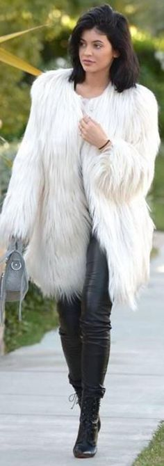 Who made  Kylie Jenner's white coat, gray handbag, and black leather pants?