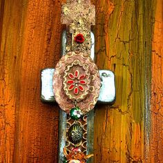 "This is a cross fashioned in the the ""old style"" we are calling Vintage. It looks much like many of the crosses that we created 20 years ago with a little flying cherub figure. It has the old ethnic qualities found in the historic Southwest religious artifacts."