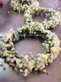 Handmade wreaths for the FlowerGirls! Baby's breath and ivory spay roses! By Betty Flowers Santorini