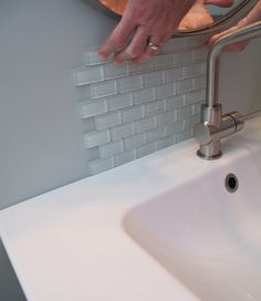 This is the last finishing touch for January: a glass tile backsplash. See the project on our blog! http://ourhaus.blogspot.com/2012/10/the-1000-or-so-bathroom-makeover-after.html#