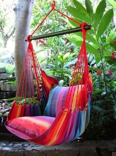 Hanging chair in rainbow color. Very nice hammock chair for in your garden. Marañon can send your hammock all over the world.