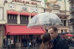 Couple kissing under umbrella at Clignancourt by TripShooter Paris photographer Jade Maitre.