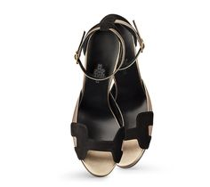 """Highlight Hermes ladies' sandal in black suede goatskin with bronze laminated nappa leather, black lining, and permabrass spur buckle. Measurement: 3.94"""" heel"""