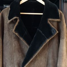 Genuine Shearling Coat - designer Suede outer, believe it's mink lined.  Bought in boutique in Aspen CO.  Michael Robinson collection.  Measures 33 inch shoulder to hem and approx 18 inch across at waist when buttoned.  Can send more pics as this square setting on iPhone doesn't do justice.  Extremely high quality, hand made.  Will have professionally leather cleaned prior to ship but not worth it if doesn't sell.  I live in FL and don't wear. Michael Robinson Jackets & Coats