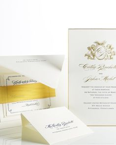 A heavenly monogram tops this navy-and-gold invitation.Bell'Invito