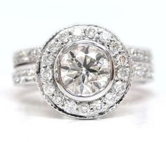 Round cut diamond engagement ring and band bezel set by KNRINC, $3999.00