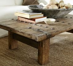 Reclaimed wood coffee table with some hardware on it.