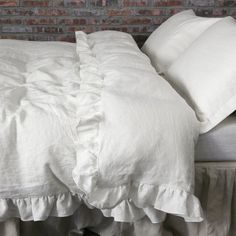 Enhanced with ruffles all around, our Pure Natural washed linen Quilt Cover is un-dyed and unbleached. Match it with ruffled shams in standard & king size.