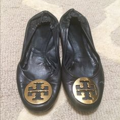 % Authentic Black Tory Burch Revas Comfy Tory Burch Revas, they are unfortunately too tight on my feet so I'm looking for a half size larger. Paint on left shoe from stepping on wet paint when I first purchased. I've had these for nearly 4 years and the damage is barely seen when worn (see last picture). No one has ever commented when worn, just been complimented on gold logo. You could possibly gently get paint off with knife or hide with something. Paint is more sheer than appears in…