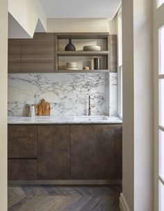 Palette of bronze with a light marble tone //  split draws and cupboards mixed