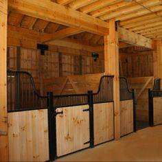 Gorgeous, clean, well ventilated and with some natural light and large stalls - how I would build my own stable.