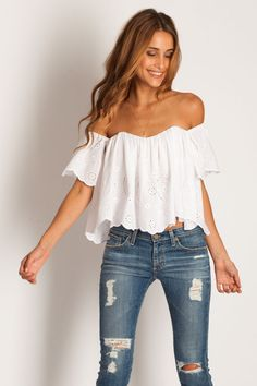 White off the shoulder top with eyelet detail paired with distressed denim. Fresh boho chic.