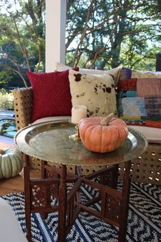 Use regular furniture mixed with your outdoor furniture and pillows and throws for a collected, homey feel