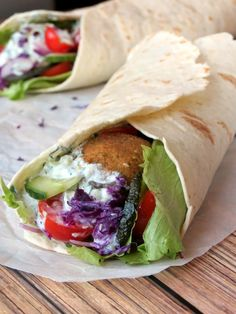 Try these healthy falafel wraps filled with salad, some vegetables, tzatziki sauce and falafel balls. It's a great option for lunch, dinner, or a snack.