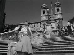 via Roman Holiday. My main memory of standing at the bottom of the Spanish Steps is the creepy Albanian man trying to sell me roses