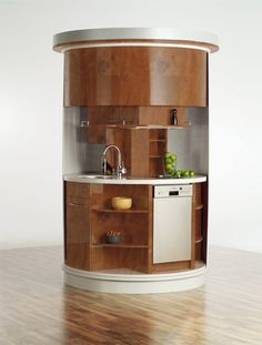 Small Round Kitchen in Wood Finish via Iroonie - maximum efficiency is maximum chic!