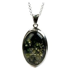 "Sterling Silver Green Amber Oval Pendant Necklace , 18"" Amazon Curated Collection, http://www.amazon.com/dp/B002DMK7GU/ref=cm_sw_r_pi_dp_0VEyrb1HRQCW3    Another possible pendant."
